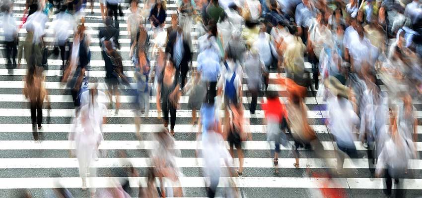 Pedestrians hurrying across a city street.