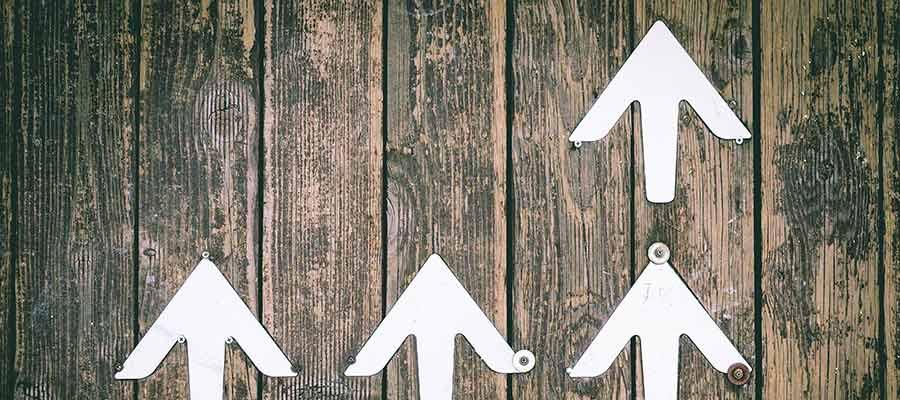 Arrows pointing upward on a wall.